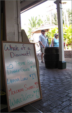 Sign of the times: A time-share office in Lahaina, Maui, dangles discounts to lure customers.