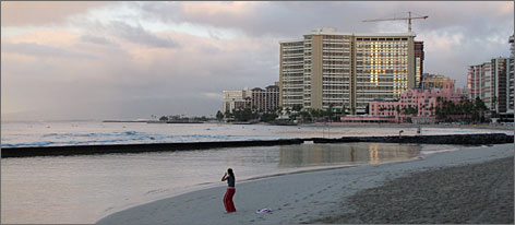 Dawn on Waikiki Beach: Though construction projects continue, Hawaii's tourism industry is reeling from the global economic slump, compounded by last summer's shuttering of two major air carriers.