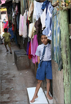 Real life: A child stands in his doorway in the Dharavi slum.