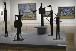 A bronze installation by Pablo Picasso is displayed with Paul Cezanne's paintings at the Philadelphia Museum of Art.