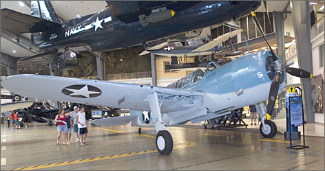 Historic aircraft are displayed at the National Museum of Naval Aviation. The museum is located on Pensacola Naval Air Station, home of the Blue Angels.