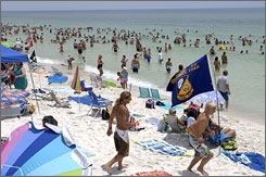 People gather on Pensacola Beach before a show by the Blue Angels.