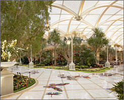 Encore?s atrium: Mosaic butterflies pave your way through the lush landscape under a vaulted ceiling.