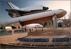 Space Camp participants walk under the Pathfinder space shuttle replica at the U.S. Space & Rocket Center in Hunstville, Ala.