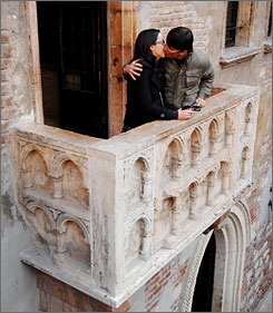 A couple kisses on the balcony of the House of Juliet where, legend has it, Romeo wooed the young maiden.