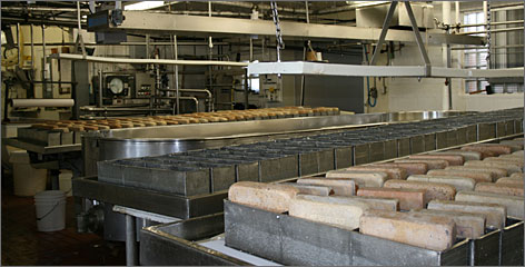 Widmer's Cheese Cellars in Theresa, Wis., is one of the last companies to use actual bricks in the making of brick cheese.