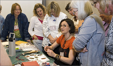 Bedazzled: A crafter demonstrates her skill to a group of onlookers at the 2008 Bead & Button Show in Milwaukee. This year's show is May 31-June 7.