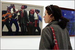 A visitor looks at Archibald J. Motley Jr.'s The Jazz Singers at the Quai Branly Museum in Paris. The Jazz Century exhibition runs through June 28.