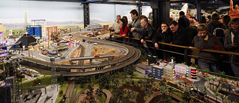 Visitors look at a model of the USA at the Miniature Wonderland in Hamburg, Germany. Billed as the world's largest model train set, it sports eight miles of track and features realistic replicas of parts of Scandinavia, Germany, Switzerland, Austria and the USA.
