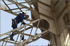 A fresh coat of lead-free brown paint is applied to Paris' Eiffel Tower. Once every seven years, every crevice, nut, bolt and beam is re-painted by hand.