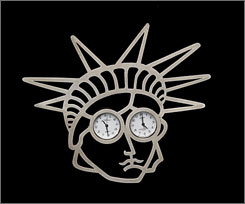 "A brooch owned by the nation's first female secretary of state under President Clinton, Madeleine Albright. It is titled ""Liberty, 1997, by Gijs Bakker, Silver 925, watches."""