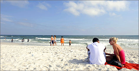 The Emerald Coast: Sun lovers enjoy the sugary sand of Florida's Pensacola Beach. Spanish explorers landed on these shores 450 years ago.