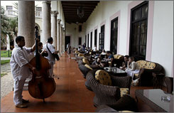 Musicians perform for tourists at the National Hotel in Havana. Cuba has about as many hotel rooms as Detroit and most are already full of Canadians and Europeans.