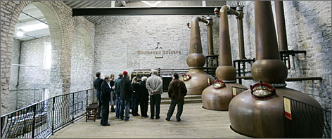 A tour group looks over the copper stills at the Woodford Reserve distillery in Versailles, Ky. The state produces more than 95% of the world's bourbon.