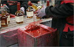 A bottle of Maker's Mark is dipped in red wax at the distillery in Loretto, Ky. Visitors can dip their own souvenir bottles after the tour.