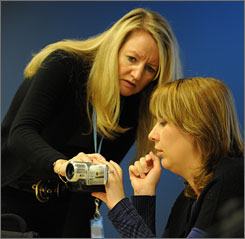 Hands-on training: Lisa Lambden, managing director of Rosenblum TV, helps student Violeta Balan figure out her rented camera.