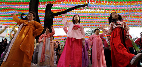 South Koreans dance to celebrate the birthday of Buddha at the Jogye Temple. Most temples are open day and night, with chants at 4 a.m., 10 a.m. and 6 p.m.