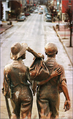 The bronze statue of Tom Sawyer and Huckleberry Finn stands at the north end of Main Street in  Hannibal, Mo.