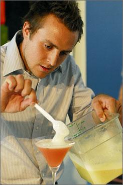 "Top it off: Jared Boller adds kiwi foam to his ""refreshing"" 42 Yuzu."