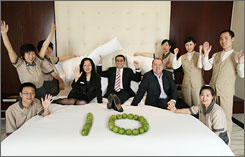 Staffers at the Westin Beijing Financial Street celebrate the 10th anniversary of the Heavenly Bed.