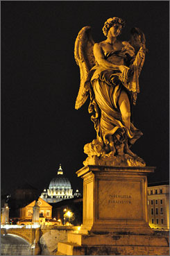 Angelic glow: St. Peter's Basilica, where parts of Dan Brown's novel Angels & Demons is set, can be seen from the Bernini-designed Ponte Sant'Angelo.