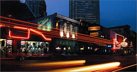 In Tennessee: Trip the country lights fantastic on Nashville's Honky Tonk Highway. Performers play for free at clubs, including Tootsies, along the stretch.