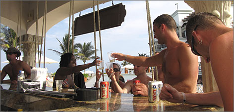Here's to good times, and affordable prices: At the Royal Playa del Carmen, Jenae Williams, left, Laurie Kuchy, Adam Kuchy and Derek Armstrong toast with tequila.