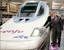 Spain's development Minister Jose Blanco, right, and U.S. Transportation Secretary Ray LaHood with a high-speed AVE train in Zaragoza, Spain. President Obama has cited Spain's bullet train network as a possible model for the U.S.