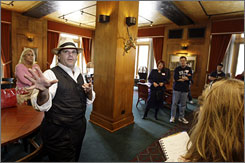 Richard Schave, docent of Raymond Chandler's Los Angeles tour, shows visitors the Bridge Room at the Los Angeles Athletic Club, a favorite haunt of the late crime writer.