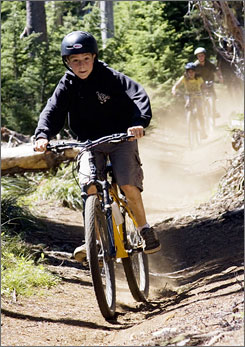 In Sisters, Ore.: Mountain bikers work up a good appetite on the trails at Big Lake Youth Camp.