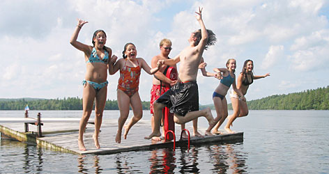 In Washington, Maine: Water is a salient element of this family camp, which boasts a sandy cove, 1 mile of private shoreline and a floating dock.