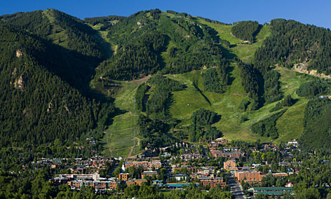 Summertime in ski country: The town sits on the valley floor between the slopes of Ajax Mountain and Red Mountain, which boasts this view.