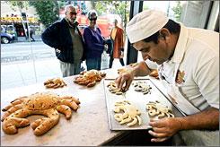 Designer dough: Ramon Padilla creates Boudin Bakery's signature sourdough French bread.