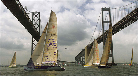 Annapolis, Md.: Boats competing in the Whitbread Round the World Race sail under the twin spans of the Chesapeake Bay Bridge.