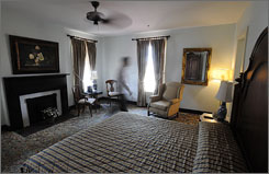 St. James Hotel manager William Ezell walks through Room 301, where Jesse James stayed. Legend says his ghost stands at the window, watching for the law.