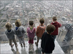 "Children stand on ""The Ledge,"" a five-sided glass box on the 103rd floor of the Sears Tower."