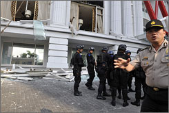 Indonesian counter-terrorist police commandos secure the damaged Ritz-Carlton hotel in Jakarta after an explosion hit the Ritz-Carlton and nearby JW Marriot hotel.