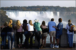 Tourists view Niagara Falls from the Canadian side. The number of U.S. visitors to Canada is at the lowest level since 1972.