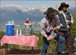 Elk Mountain Ranch staff members prepare afternoon brunch for guests at Alpine Ridge near Buena Vista, Colo. The family-operated dude ranch has seen a drop-off in bookings this summer.
