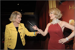 Joan Rivers poses with her wax counterpart at the new Madame Tussauds in Hollywood.
