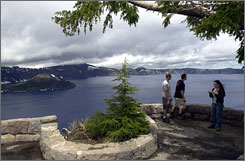 A Bend, Ore., tour company has applied for permission to fly over Crater Lake 300 times a year.
