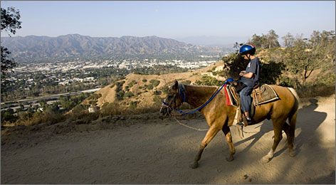 In Los Angeles' Griffith Park, known for the famous Hollywood sign that overlooks the city, you can hop on a horse for a sunset ride.