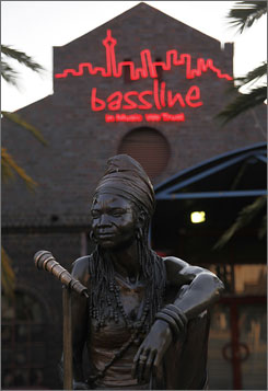 "A bronze statue of the late Brenda Fassie, a local pop singer known as the ""Madonna of the Townships,"" sits outside the Bassline Jazz Club."