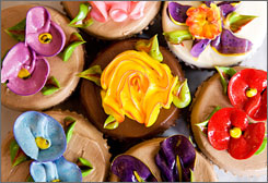 The Cupcake Cafe's cupcakes are known for beautiful buttercream frosting, designed to resemble flowers.