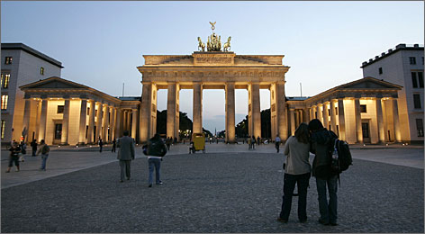 Tourists stroll in front of the Brandenburg Gate in Berlin. Getting to Germany might seem like a big expense, but several airlines are offering fares for less than $500 this fall.