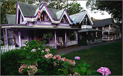 "Painted ladies: Colorful, Victorian ""gingerbread cottages"" are a tourist attraction in Oak Bluffs."