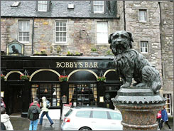 A statue of a Skye terrier sits outside Greyfriars Bobby's Bar. The dog kept watch over its owner's grave for 14 years until his own death.