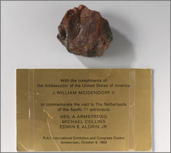 Amsterdam's Rijksmuseum displays a rock supposedly brought back from the moon with a note from the then-U.S. ambassador. Museum officials now say one of their prized possessions is really a piece of petrified wood. 