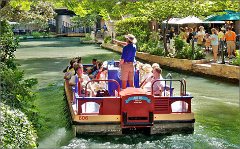 All aboard the Miss Iris: Visitors can float alongside San Antonio's River Walk during narrated tours on the San Antonio River. Dining boats are available, too.