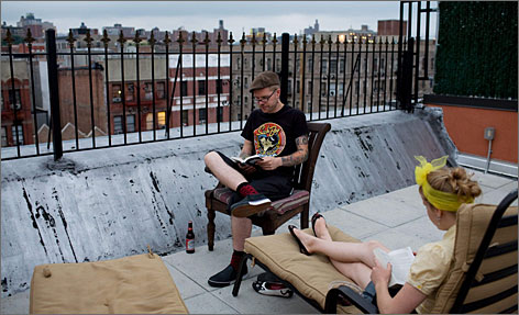 The patio of New York's L-Hostels offers a view of Harlem rooftops.